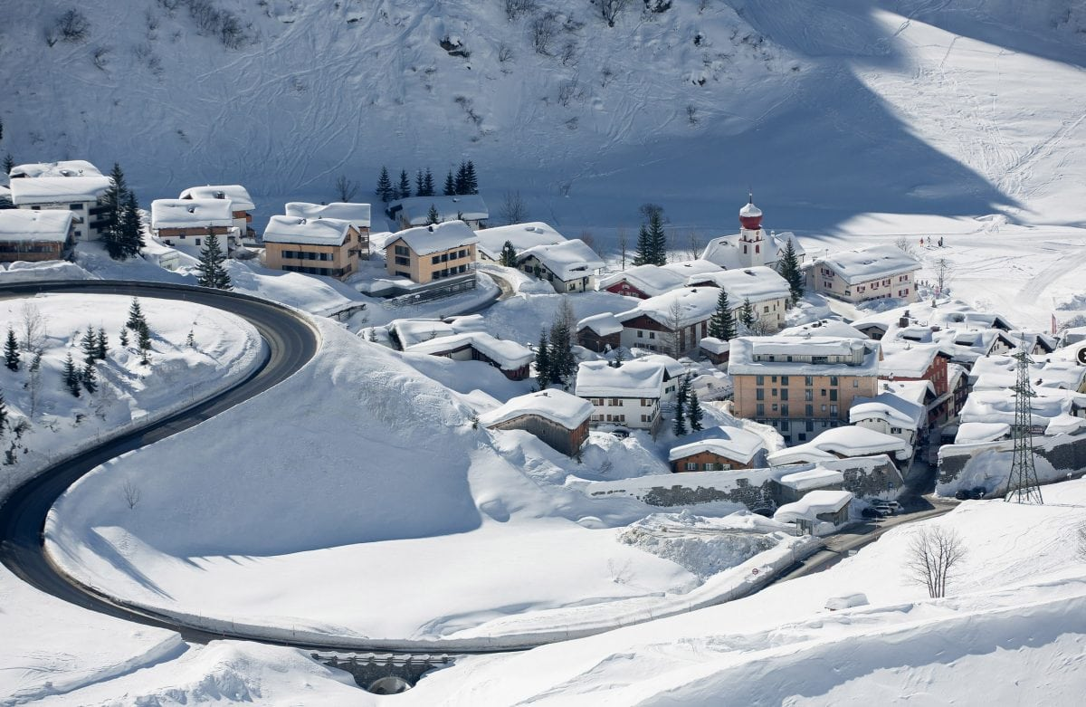 Sunny and snowy distance view of the ski village of Stuben am Arlberg.