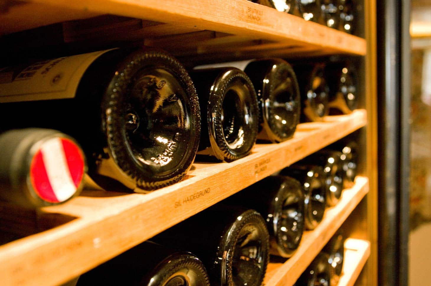 Close up of several bottles of fine wine stores within the Hotel's wine cellar.r